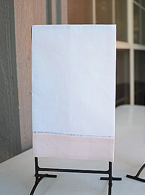 Light Pink colored trimmed hand towel