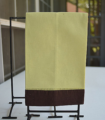 festive multi colored hand towel. mellow green & brown