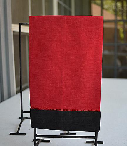 festive multi colored hand towel red & black