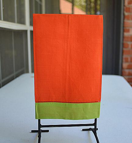 festive multi colored hand towel. orange & green