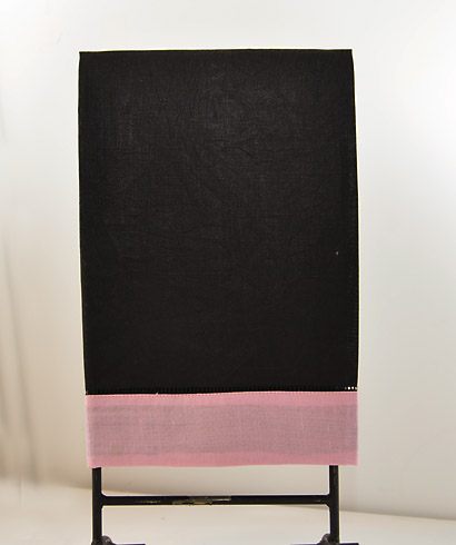 festive multi colored hand towel. black & Pink