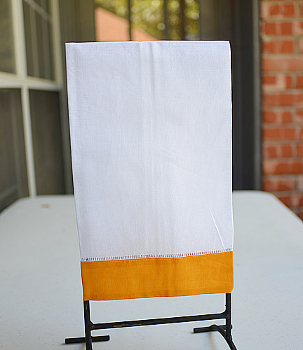 Apricot colored trimmed hand towel
