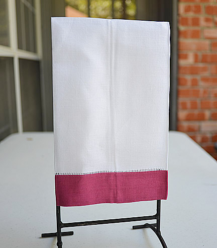 Sangria colored trimmed hand towels