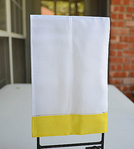 Kumquat colored trimmed hand towel